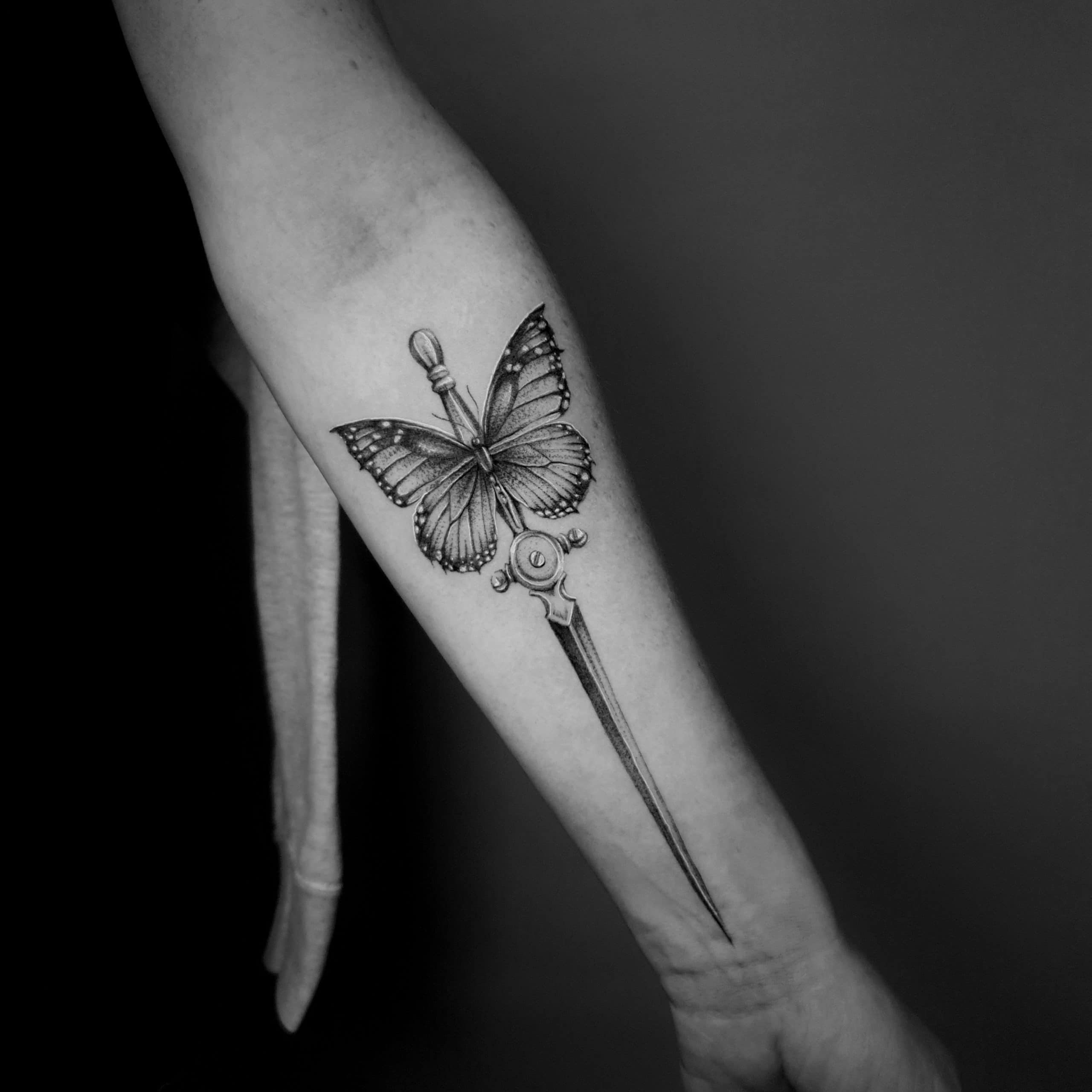moth tattoo dagger