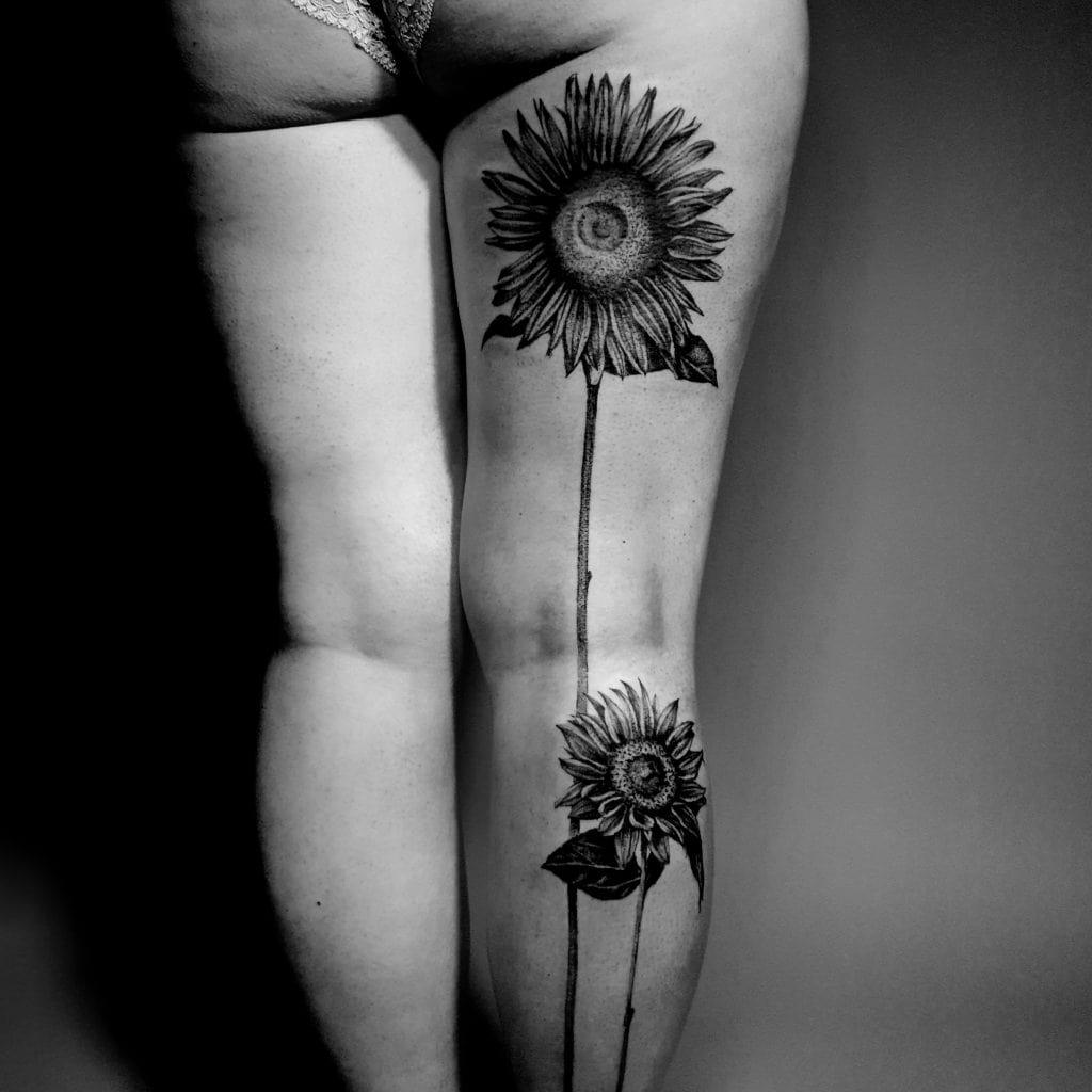 floral sunflower thigh tattoo